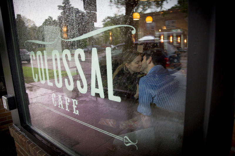06-colossal-cafe-coffee-shop-saint-paul-minnesota-rainy-day-engagment-session-couple-through-the-window-melanie-mahonen-photography