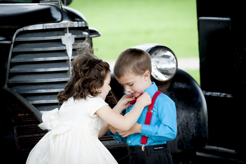 12-flower-girl-fixes-ring-bearer-tie-cute-spring-wedding-you-cant-make-this-stuff-up-melanie-mahonen-photography