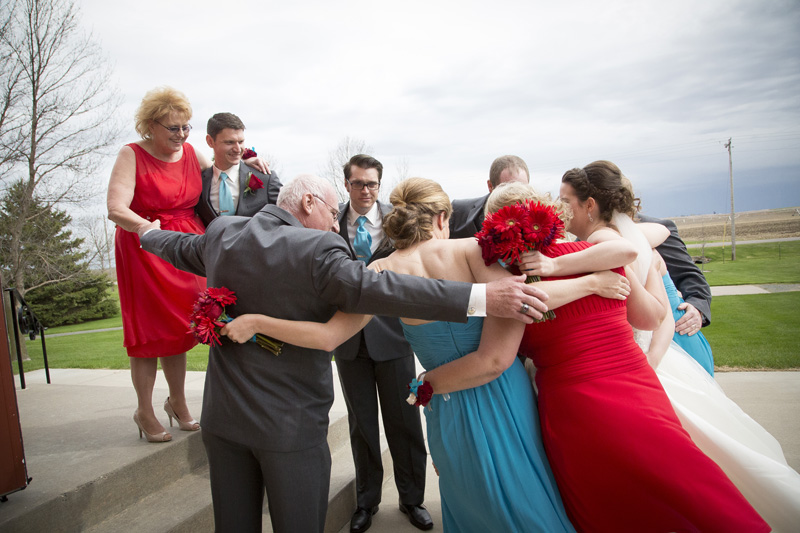 13-little-loghouse-pioneer-village-hastings-minnesota-group-hug-pre-ceremony-excitement-melanie-mahonen-photography