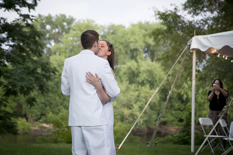15-bride-groom-firsst-dance-casual-bakcyard-summer-wedding-reception-emotion-kiss-melanie-mahonen-photography