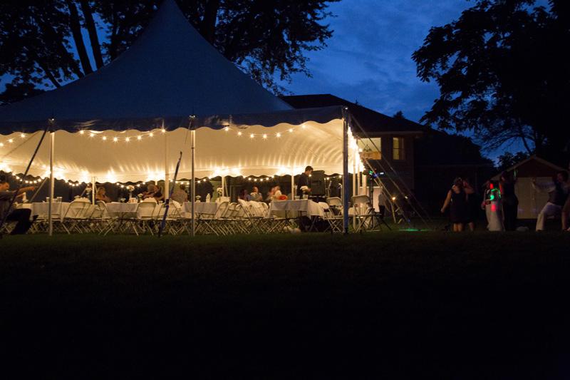 backyard-wedding-tent-reception-lights-night-melanie-mahonen-photography