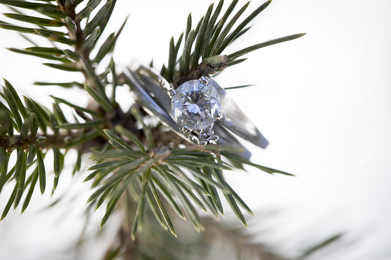 winter-wedding-ring-detail-shot-spruce-tree-snow-melanie-mahonen-photography