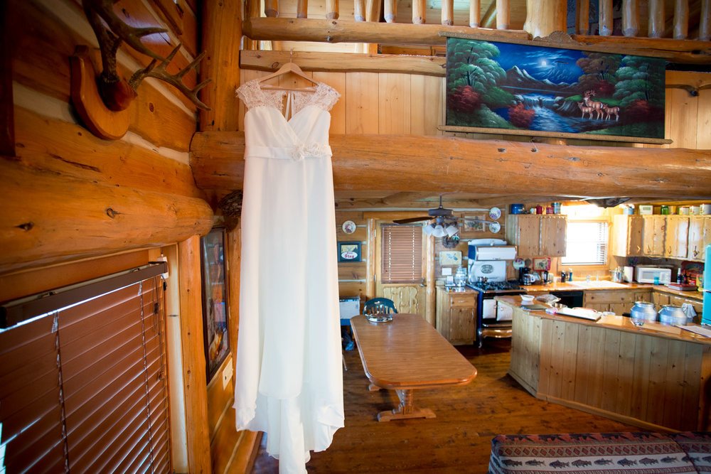 02-hayward-wisconsin-northwoods-cabin-wedding-day-detail-shot-bridal-gown-white-dress-mahoenen-photography