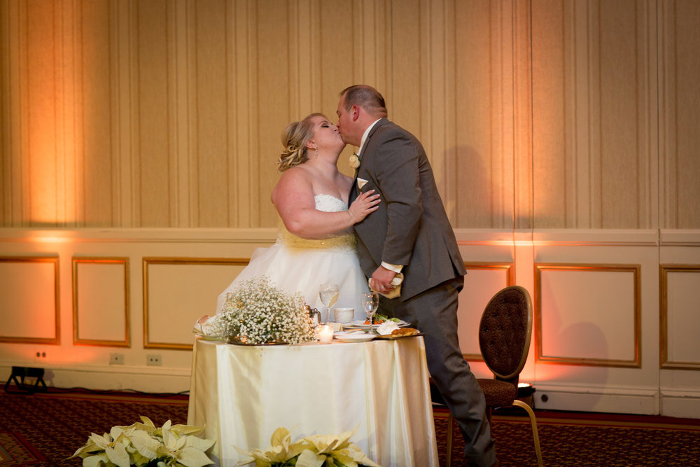16-the-st-paul-hotel-minnesota-wedding-reception-bride-and-groom-kiss-mahonen-photography.jpg