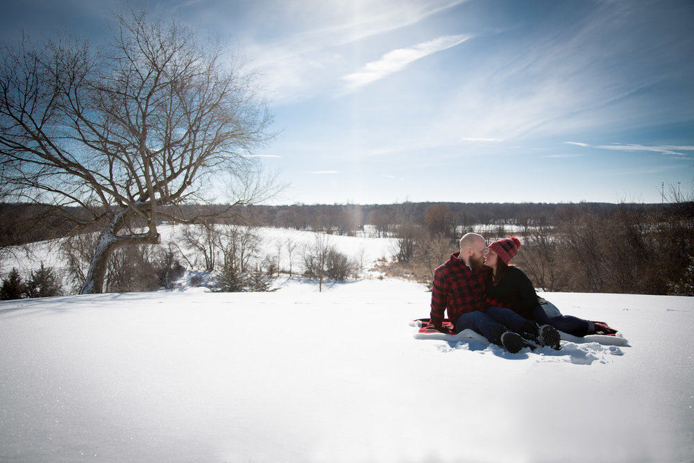 01-winter-wonderland-engagement-session-red-plaid-cozy-flannel-open-farm-field-minnesota-mineapolis-st-paul-twin-cities-wedding-photographer-mahonen-photography-01.jpg