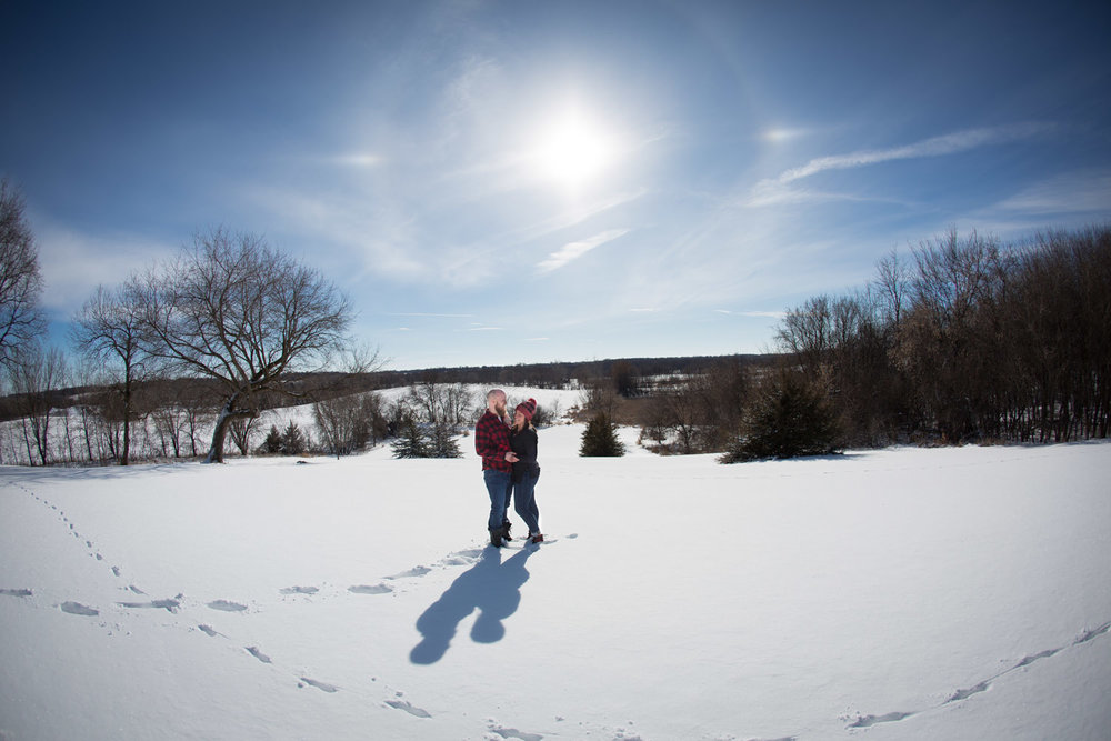03-winter-wonderland-engagement-session-open-farm-field-blue-sky-fun-sunny-snow-minnesota-minneapolis-st-paul-twin-cities-wedding-photographer-mahonen-photography.jpg