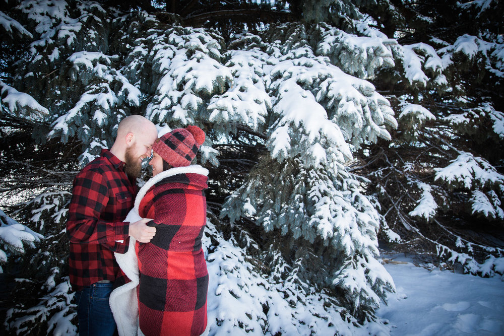 05-winter-wonderland-engagement-session-snowy-pine-trees-blue-sky-fun-sunny-snow-minnesota-minneapolis-st-paul-twin-cities-wedding-photographer-mahonen-photography.jpg