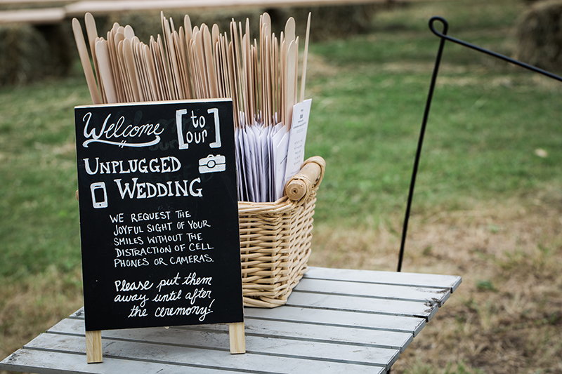 It's easy to politely let your guests know that you are having an unplugged ceremony. Some couples put out a cute sign, others chose to have their officiant make an announcement prior to the ceremony.