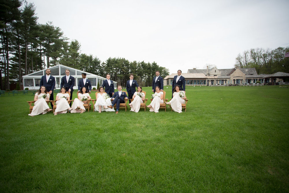 07-bishops-bay-country-club-middleton-wisconsin-wedding-party-group-portrait-lawn-adirondak-chairs-navy-blue-suits-pale-pink-bridemaids-dresses-mahonen-photography.jpg