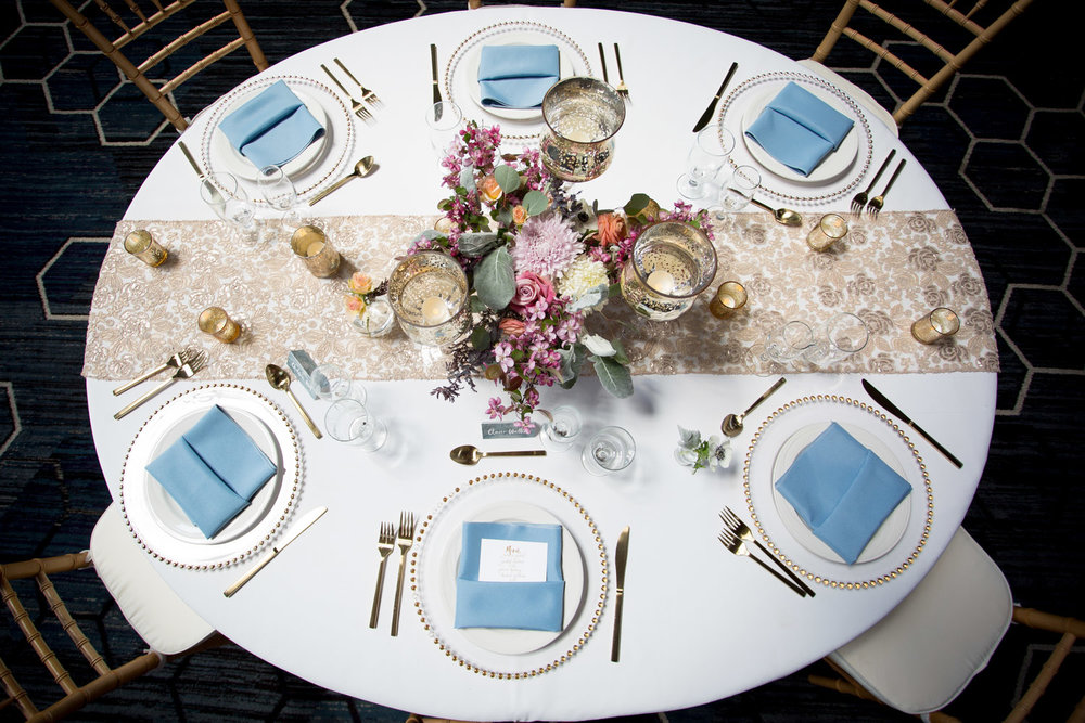 03-double-tree-park-place-by-hilton-atrium-weddings-st-louis-park-minneapolis-minnesota-wedding-photographer-styled-shoot-head-table-easy-glamourous-style-gold-floral-runner-powder-blue-napkins-pocket-fold-menu-clear-charger-plate-mahonen-photography.jpg