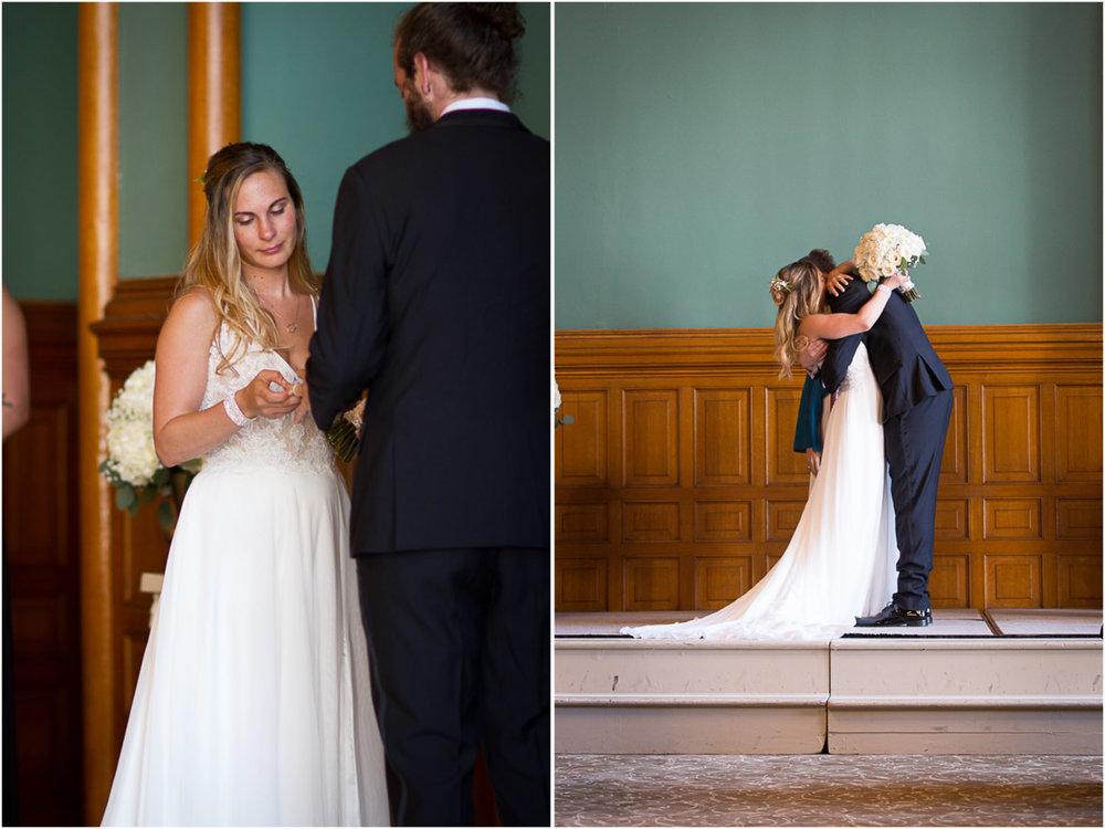 15-the-landmark-center-st-paul-mn-wedding-photographer-ceremony-ring-exchange-first-kiss-mahonen-photography.jpg