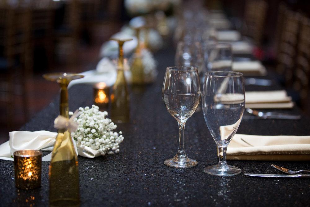 21-the-landmark-center-st-paul-mn-wedding-photographer-reception-details-head-table-setting-black-sequin-linen-gold-napkins-mahonen-photography.jpg