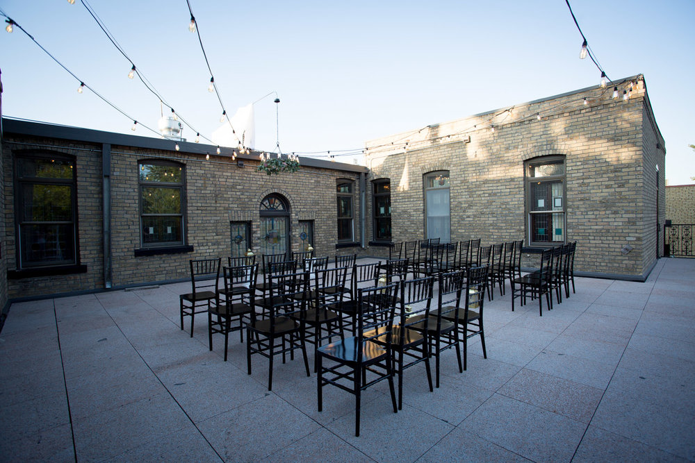 26-hotel-broz-new-prague-mn-minnesota-wedding-venue-photographer-styled-shoot-rooftop-ceremony-space-black-chairs-mahonen-photography.jpg