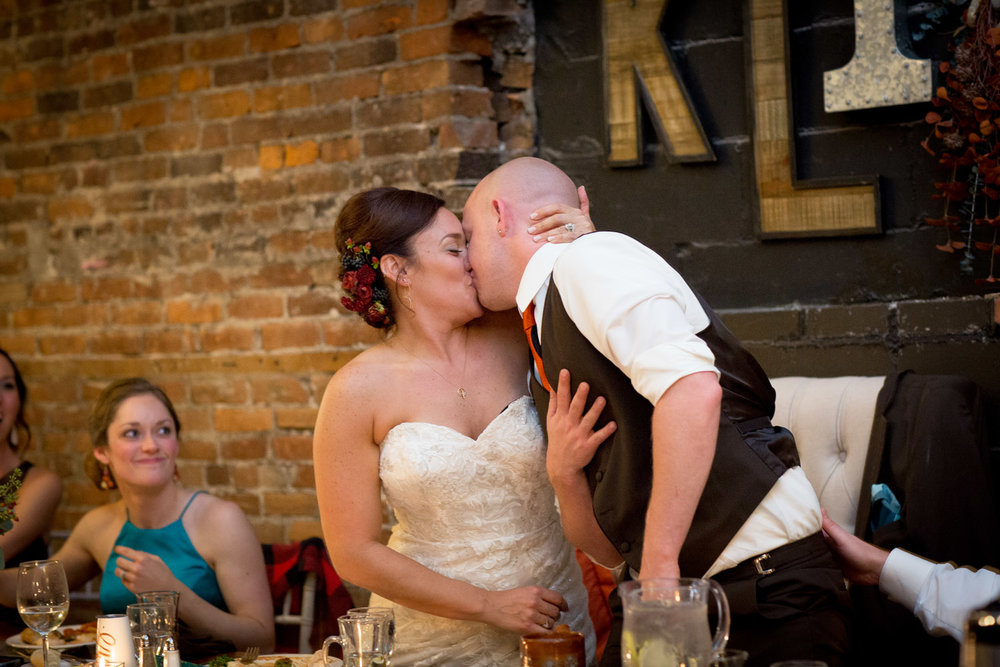 27-loft-at-studio-j-stillwater-mn-wedding-reception-fun-toasts-kisses-minnesota-photographer-mahonen-photography.jpg