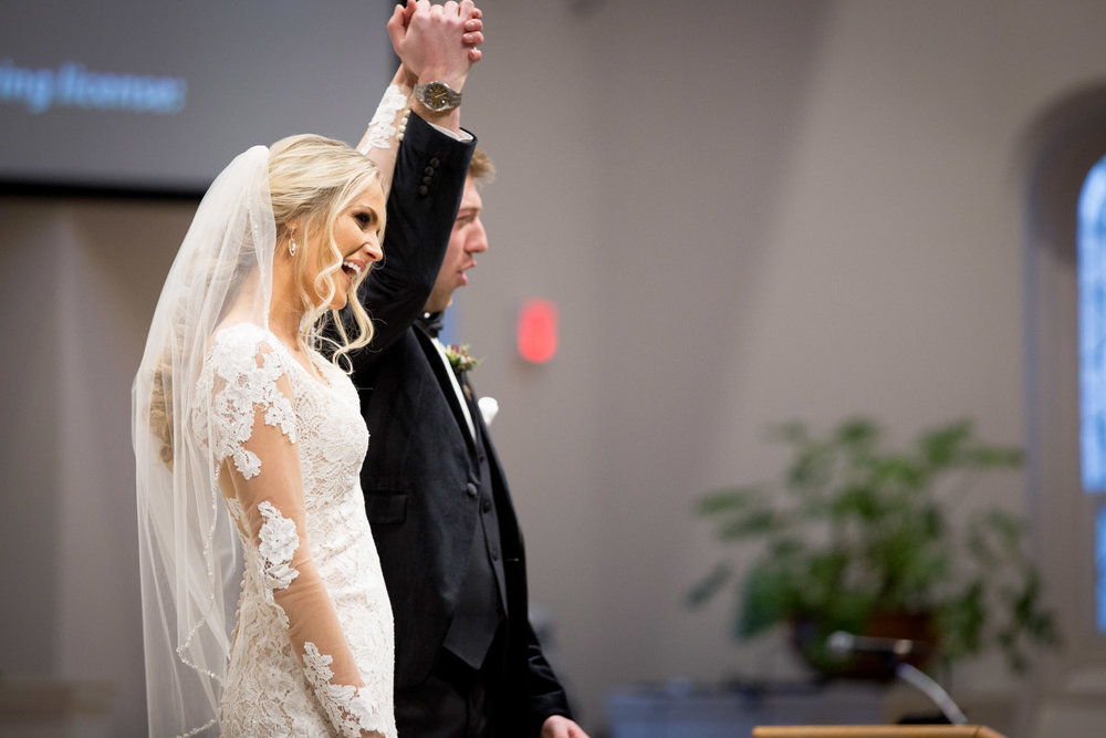08-st-mary-of-the-lake-white-bear-minnesota-catholic-winter-wedding-ceremony-husband-and-wife-mahonen-photography.jpg