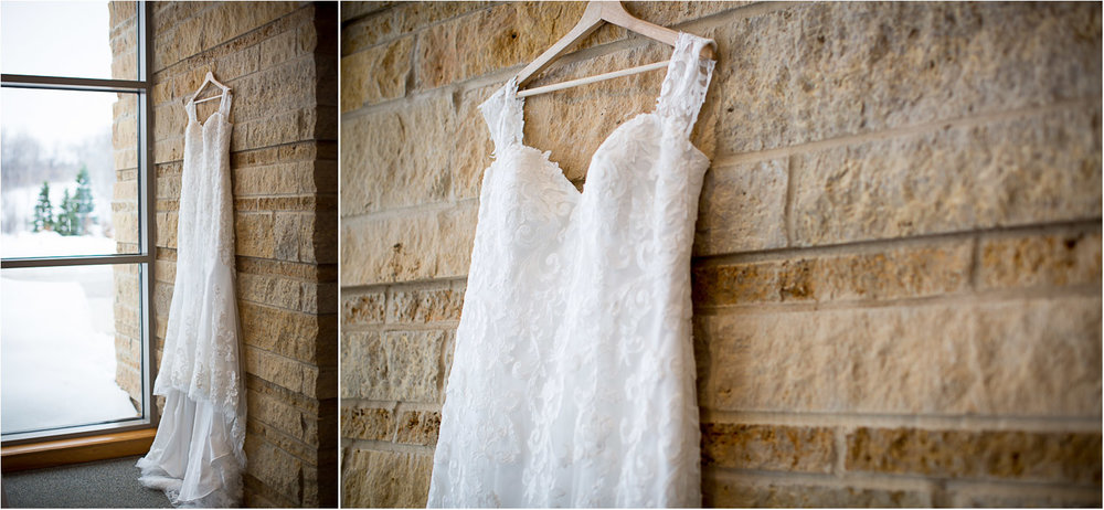 01-eagan-community-center-weddings-minnesota-winter-wedding-dress-detail-lace-limestone-wall-mahonen-photography.jpg