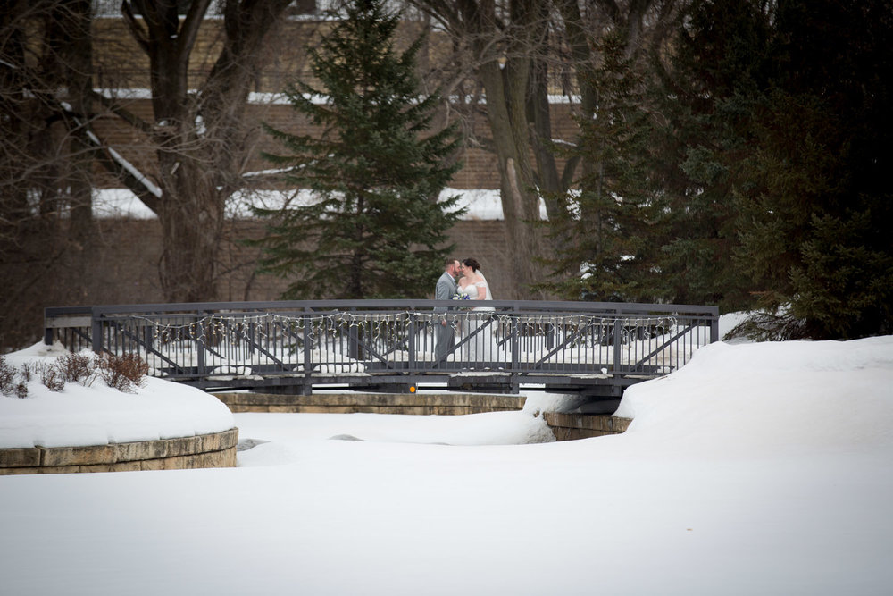 07-eagan-community-center-weddings-minnesota-winter-wonderland-wedding-bride-groom-bridge-mahonen-photography.jpg