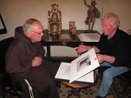 Kim Weston - Giving Father Larry a portfolio from a prior workshop