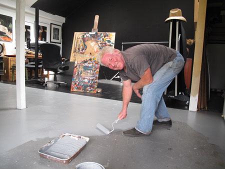 An image of Kim Weston painting his studio floor