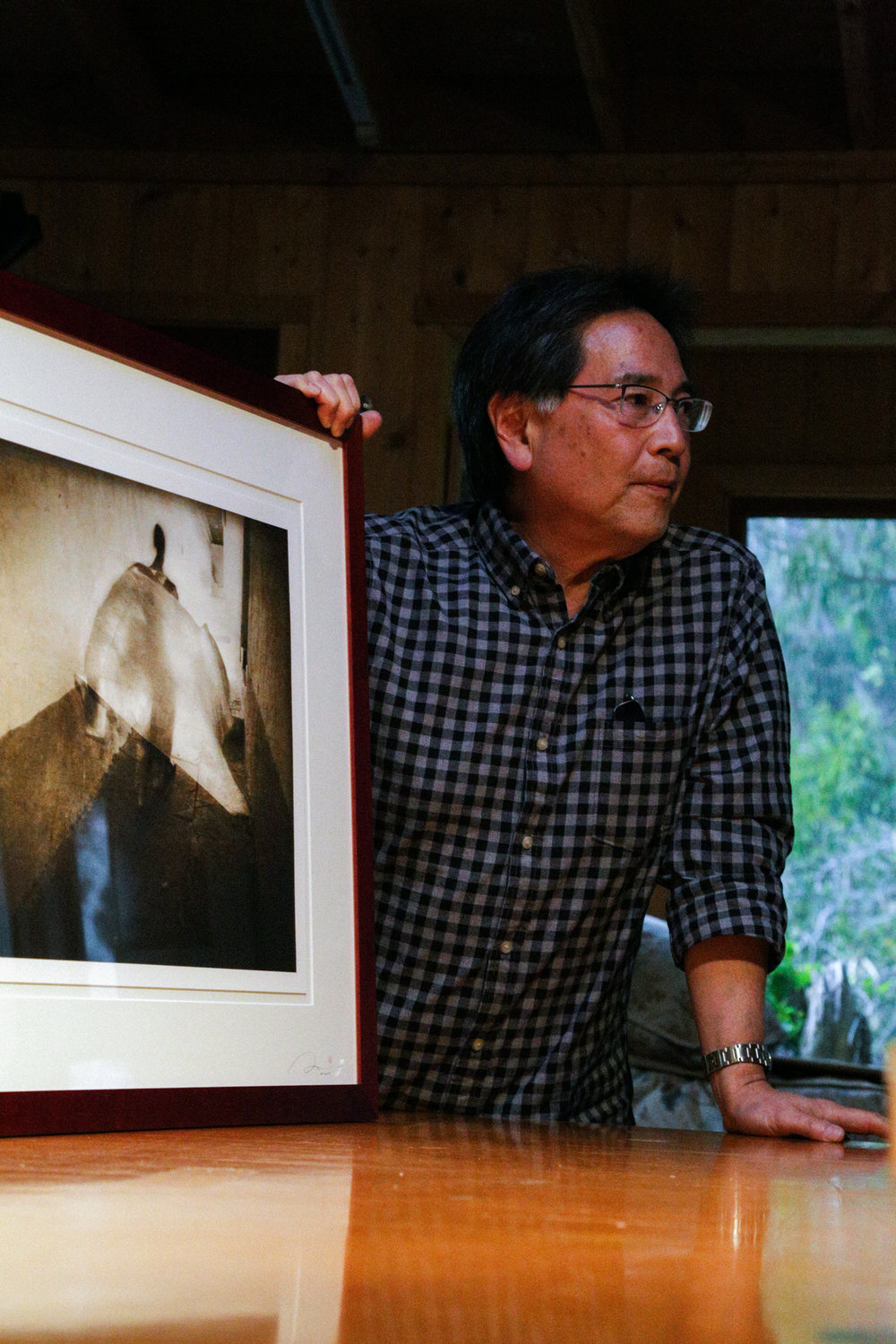 Rick Murai shows his work to Weston Photography Workshop participants in the gallery on Wildcat Hill.  Photo by Annabelle Scott