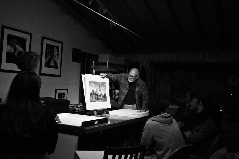 Huntington Witherill shows his work to Weston Photography Workshop participants in the gallery on Wildcat Hill.  Photo by Annabelle Scott