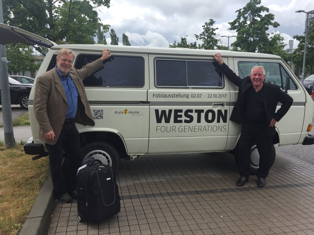 Friedrich Saller and Kim Weston pose next to the official Four Generations of Weston Photography van!