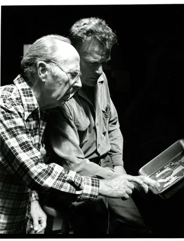 Edward reviewing Brett's printing abilities