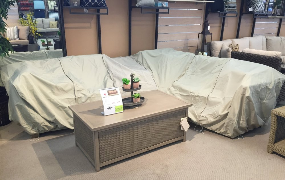 Patio furniture protective covers on sectional sofa in Williams Ski and Patio showroom.