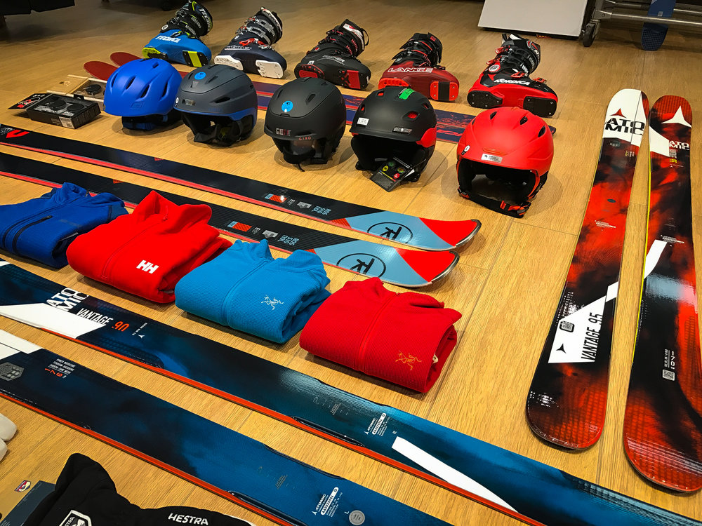 Red and blue ski clothing and equipment color story.