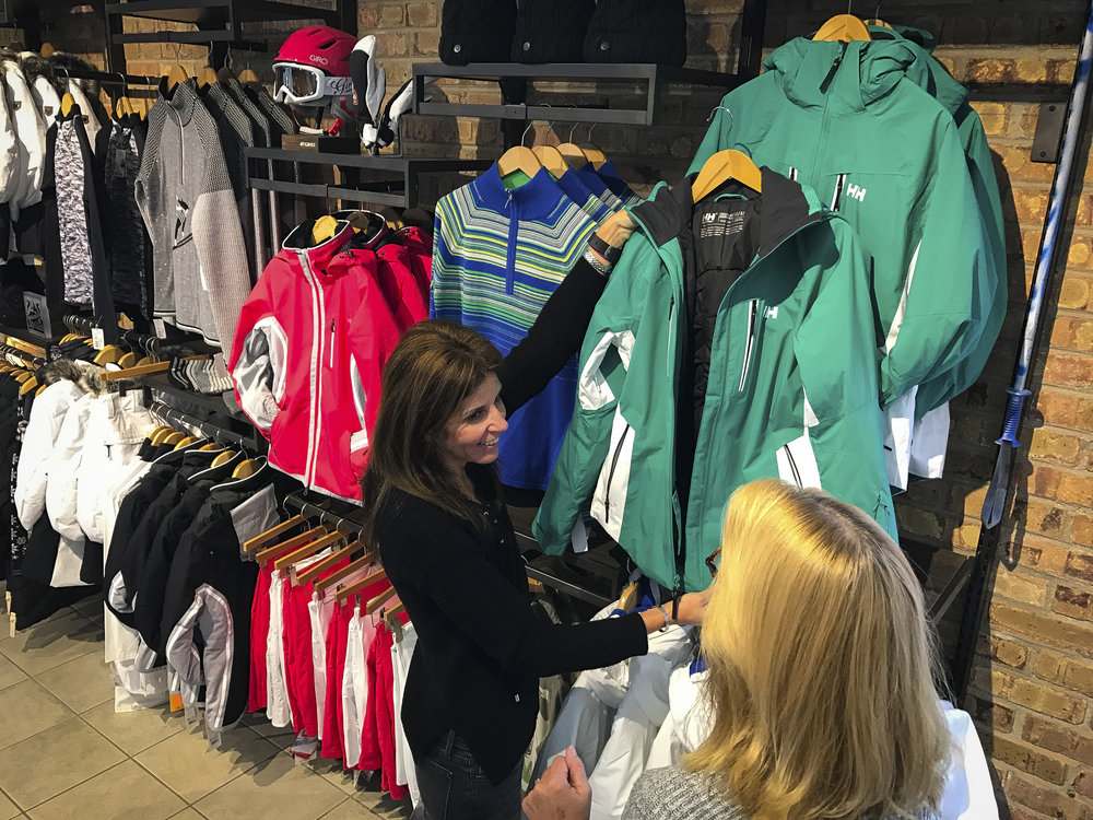 Customer being helped in clothing department by Williams Ski and Patio team member.