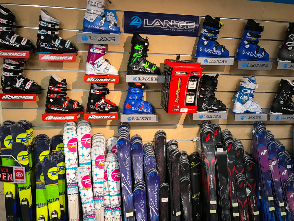 Close up of Williams Ski and Patio junior trade-in ski equipment wall.
