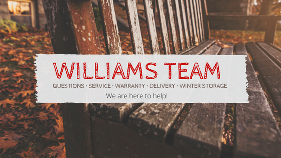 Williams team banner over old teak bench needing service.