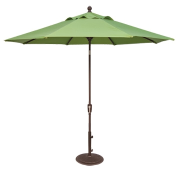 Close up of open green patio umbrella.