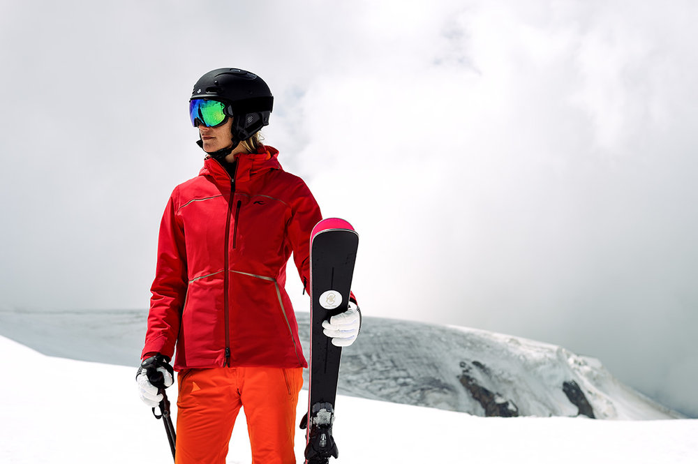 Woman with ski clothing & equipment from Williams Ski & Patio