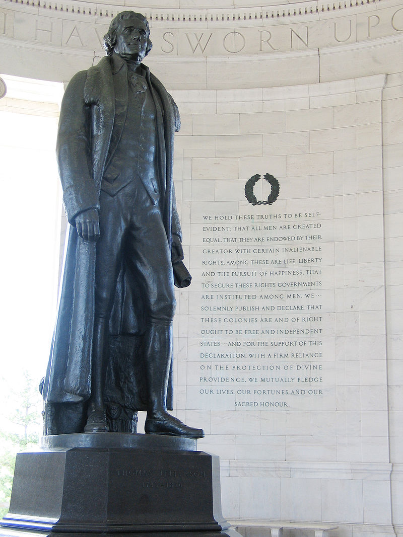 "The preamble to the Declaration of Independence, which includes the phrase ""life, liberty, and the pursuit of happiness"" in the background at the Jefferson Memorial in Washington, D.C."