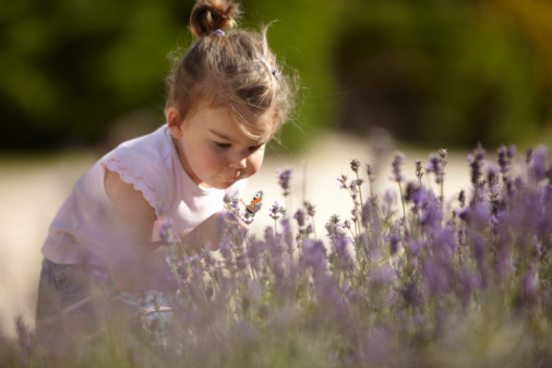 Girl smelling flower.jpg