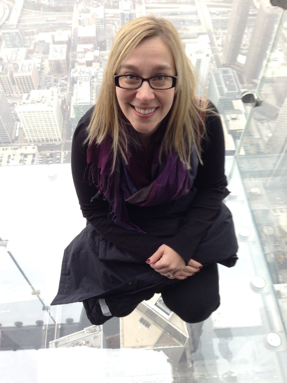 Steph, on the ledge of the Skydeck of the Willis Tower in  Chicago