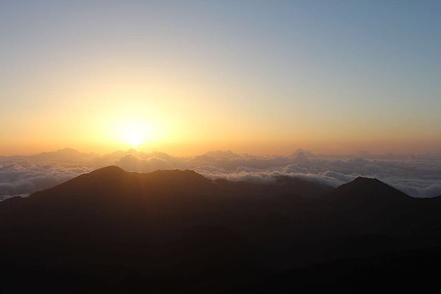 """Seeing the sun rise above the clouds at 10,000 feet in Haleakala National Park (Maui) is a memory that will last a lifetime. Haleakala means 'house of the sun"""" and is a magical place to witness the dawn as you listen to the mele oli, a chanted free verse poem. Instead of driving yourself, hooking up with a bicycling tour company is a fun way to experience the start of a new day. It's probably the only 10 mile bike ride where you consume more calories than you burn as you make your way back down to sea level, stopping for a hearty pancake breakfast along the way. Grab a catnap in the afternoon so you can watch the sunset that evening and say aloha (hello and goodbye) to the day! #wheretowednesday #letthetriptakeyou #travelworthy #wanderlust #vacation #travel #travelgram #hawaii #aloha #haleakala #sunrise #sunset #maui"""