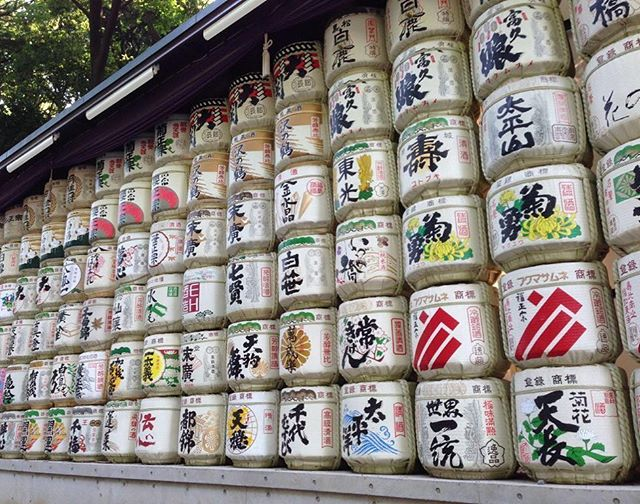 Sake Time! This colorful installation is a collection of sake barrels outside of Meiji Jingu Shrine in Tokyo, Japan. Sake is a rice wine that is created through a fermentation process similar to beer and is often drank ceremoniously in religious purification rituals. It's a Japanese belief that sake unifies Gods and people, therefore you often find similar displays near Shinto shrines. These barrels are empty, so it's best to sample some of Japan's finest at your local bar or restaurant. Kanpai! #wheretowednesday #letthetriptakeyou #travelworthy #wanderlust #vacation #travel #TravelGram #japan #sake #tokyo