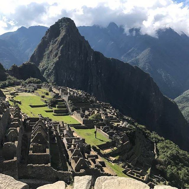 """Machu Picchu (translated as """"Old Mountain"""") is located high in the Andes in Peru and is one of the world's most well-known sacred places. This Incan citadel was built in the 15th century is still renowned for its sophisticated dry-stone walls, although it's exact former use remains a mystery. You can access it by hiking/camping your way on the Inca Trail or by taking the scenic Vistadome train to the nearby town of Aguas Calientes. Regardless of your mode of transit, be prepared for breathtaking beauty! #wheretowednesday #letthetriptakeyou #travelworthy #wanderlust #vacation #travel #TravelGram #peru #machupicchu #incatrail #hike #vistadome #andesmountains"""