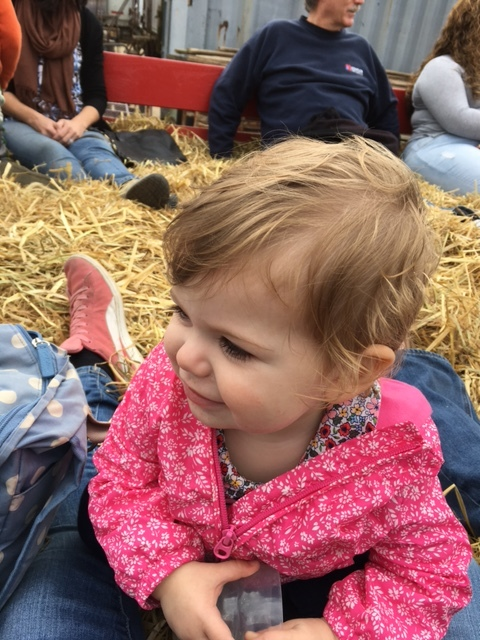 Enjoying her first hay ride