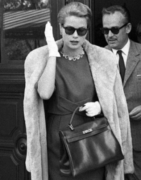 Grace Kelly carries the iconic original Hermes Kelly bag.