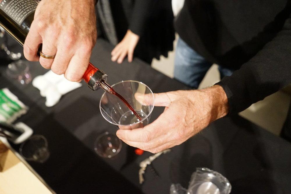 Pouring Via Romano wine