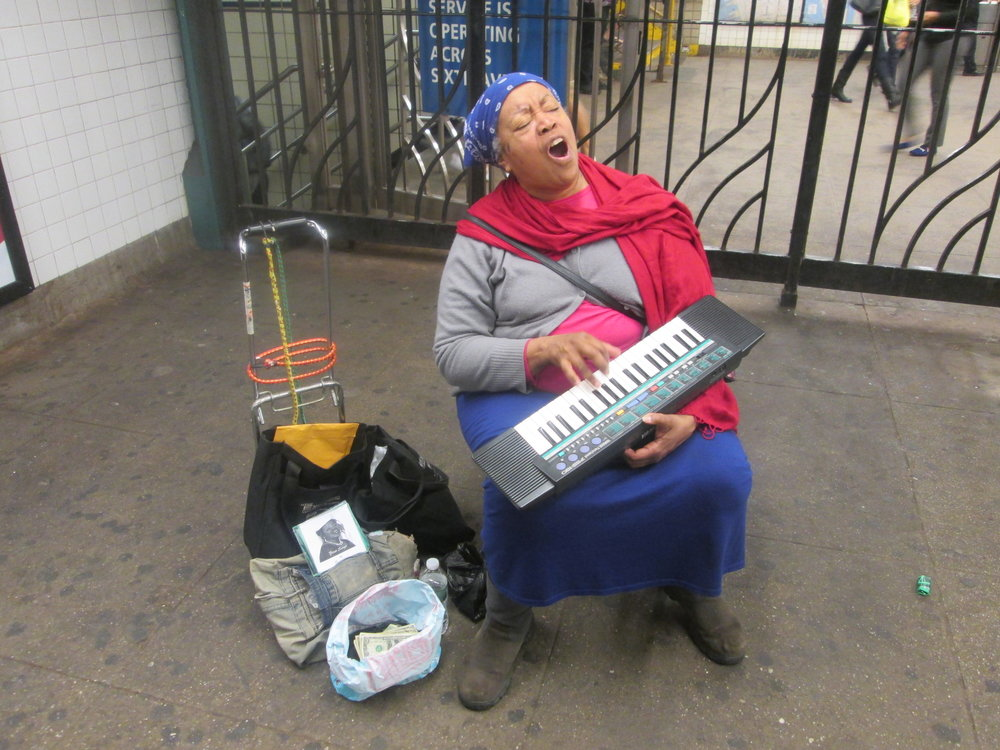 Rosa Teresa a long time NYC subway performer at 23rd St and 6th Avenue Station, 2015