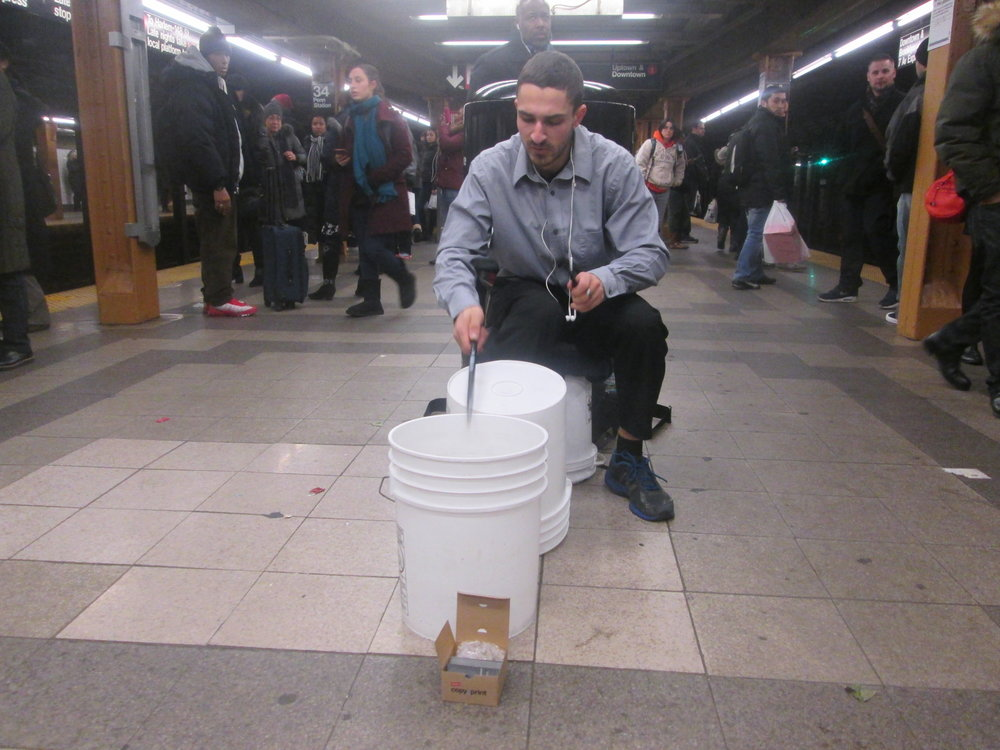Panos, a bucket drummer performing at 34th Street and 7th Avenue Station, 2016