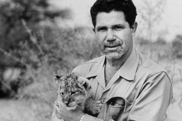 LIFE photographer John Dominis holds a lion cub. (Source:  Time.com )
