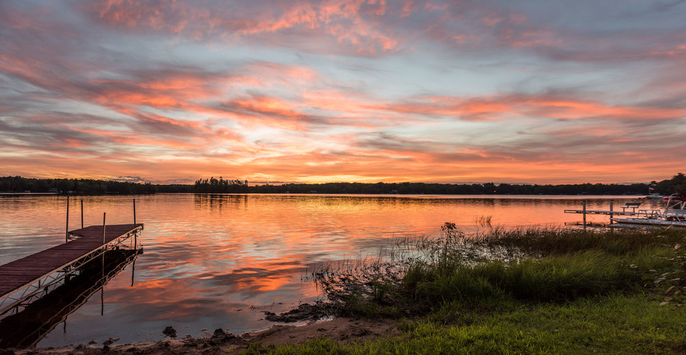 I was shooting a wedding at a golf course next to Bass Lake, north of Antigo, WI, when we were struck by this incredible view.  Along with some beautiful portraits of the lovely couple, I captured this four-image panoramic.  Shot on a Nikon D810, 24-70mm and stitched in Lightroom. Keep an eye out for the rest of the photos, coming soon!