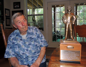 "Duffy admiring ""The Duffy."" The coveted award presented to IKF National Champions.      Photo: Graeme Barwick"