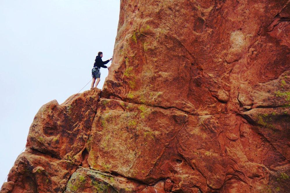 Man versus nature in garden of the gods (near colorado springs)