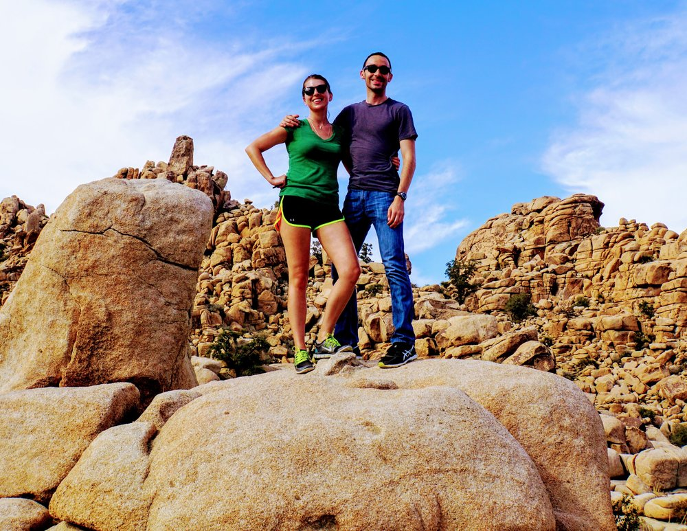 It's us! Here we take a brief reprieve from the car to climb around joshua tree national park.